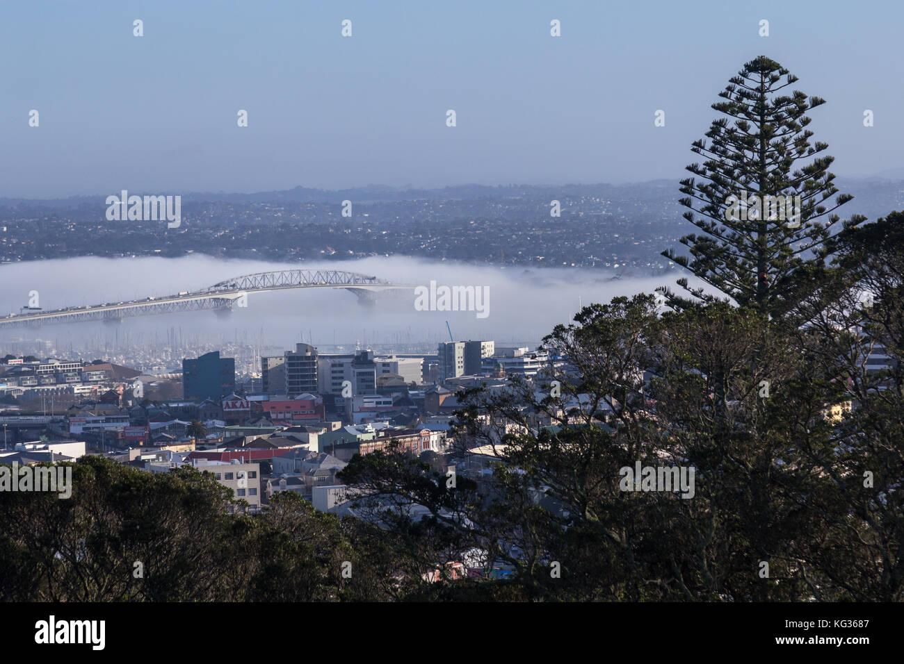 Fog around Auckland Harbour Bridge, Auckland, New Zealand - Stock Image