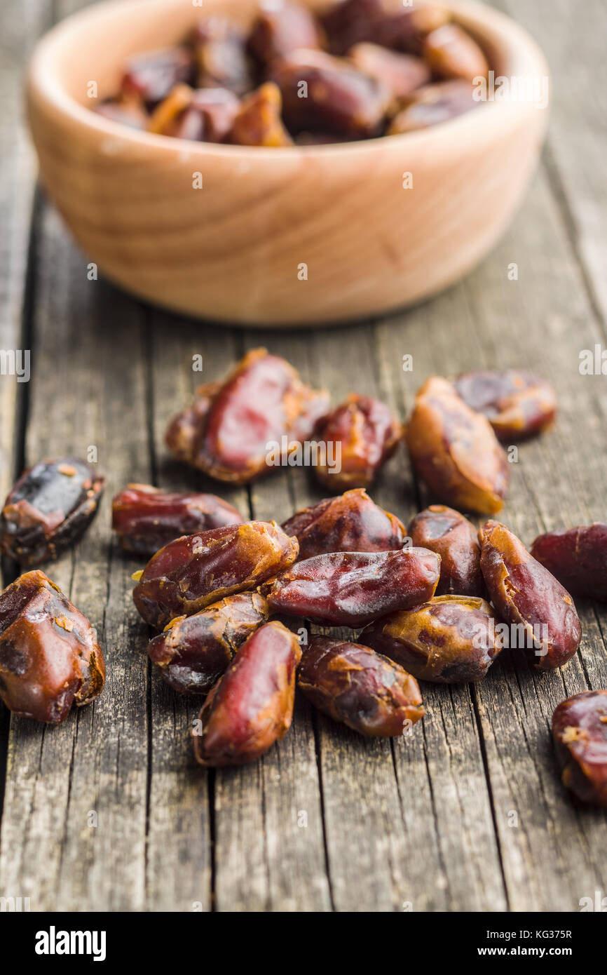 Sweet dates without stones on wooden table. - Stock Image