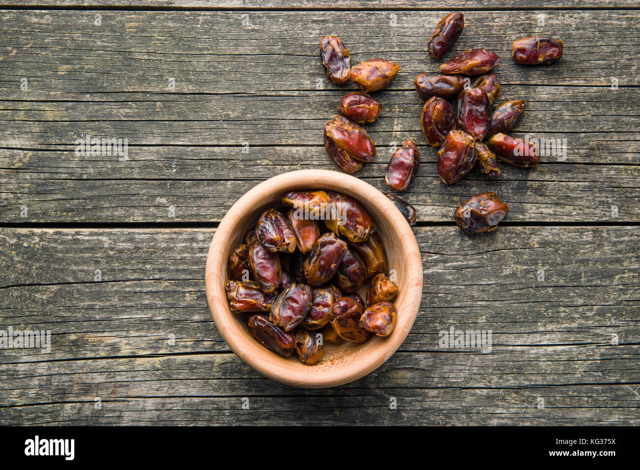 Sweet dates without stones in bowl. - Stock Image