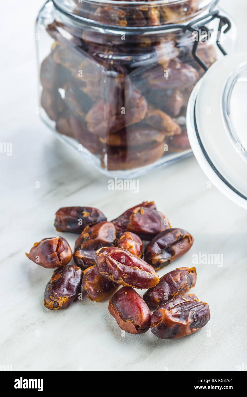 Sweet dates without stones on kitchen table. - Stock Image