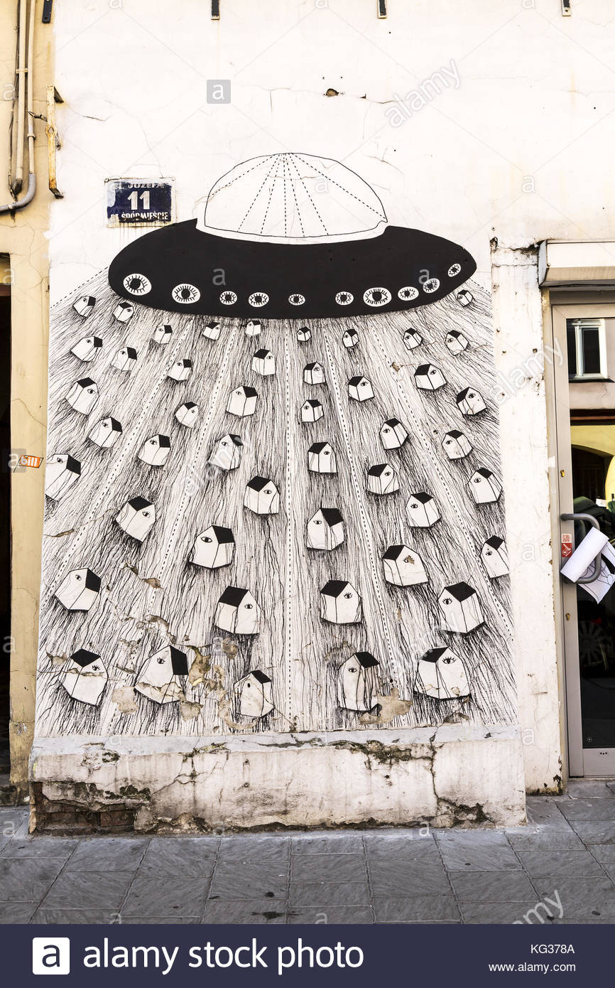 Unattributed wall art on the buildings of the artist area of Krakow - Stock Image