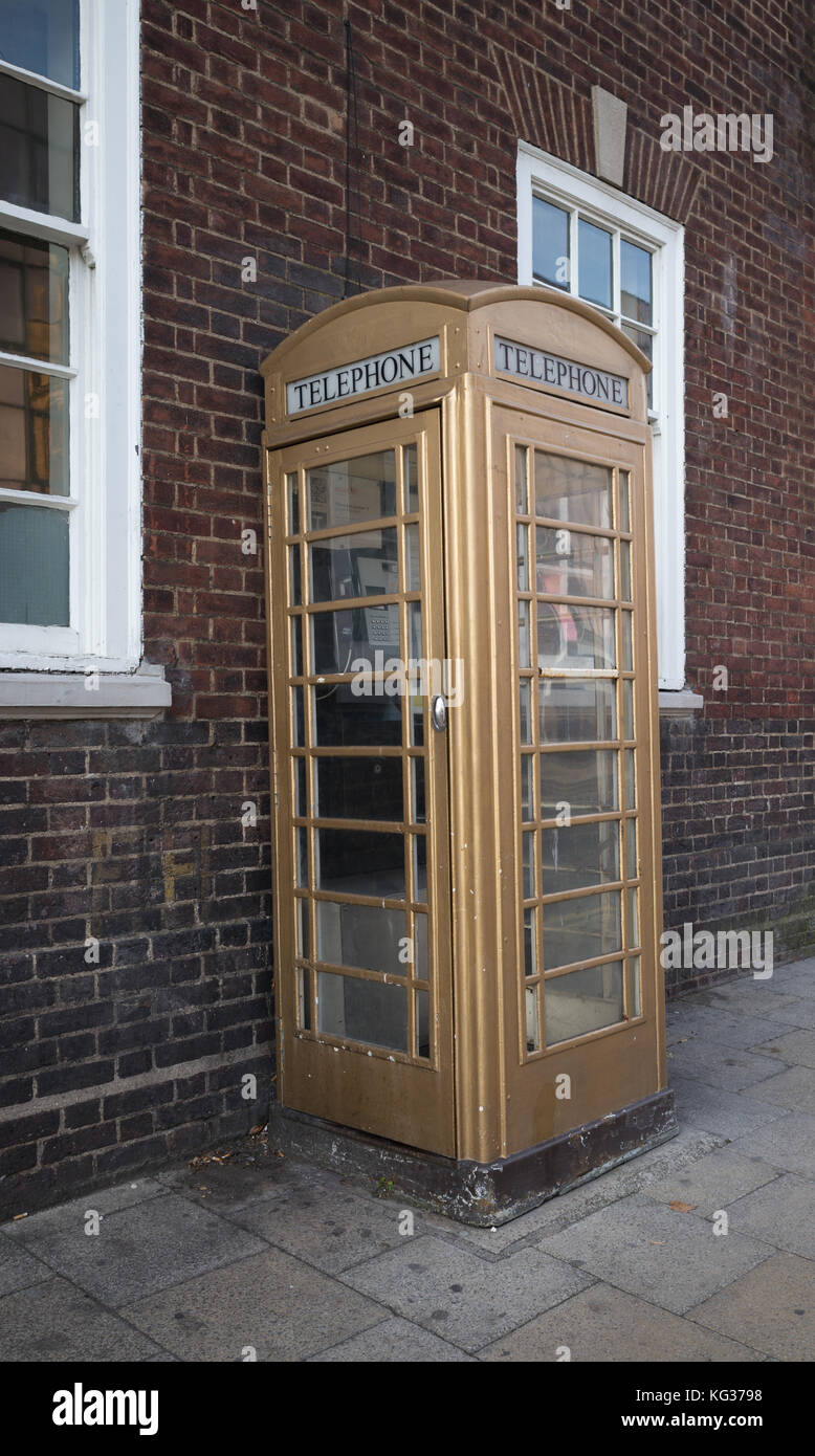 Telephone box in colour of Kingston upon Hull telephone company, Kingston upon Hull, UK - Stock Image