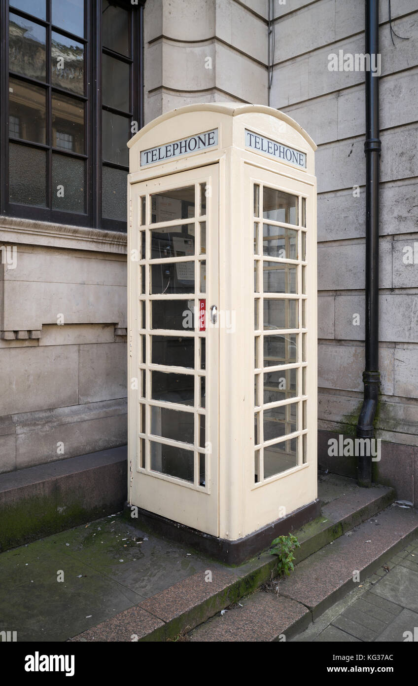 Telephone box in cream colour of Kingston upon Hull telephone company, Kingston upon Hull, UK - Stock Image