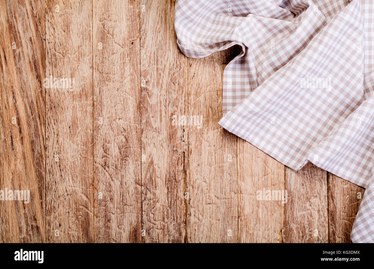 checkered tablecloth on wooden table background Stock Photo