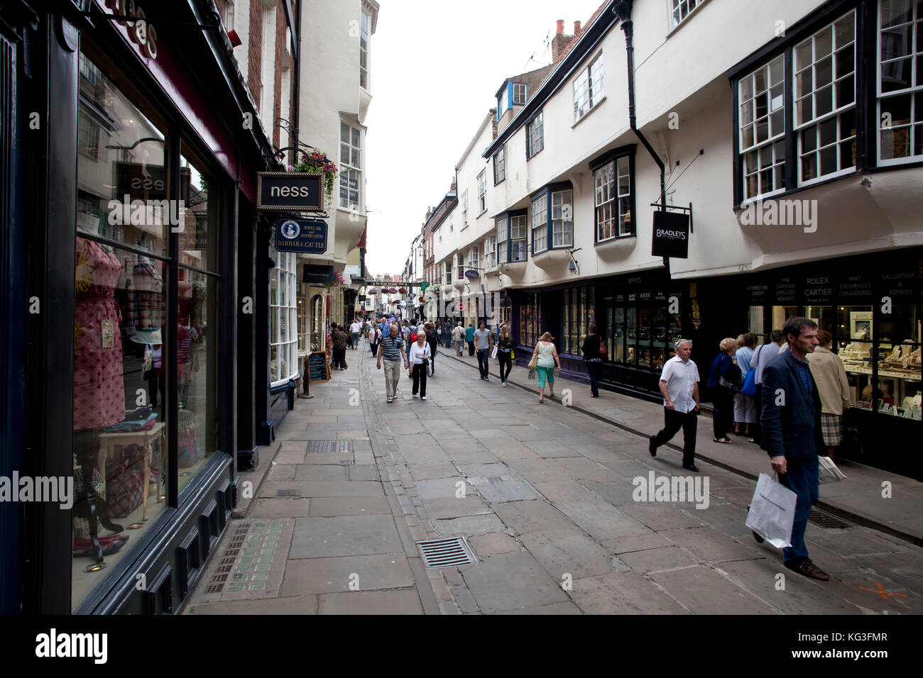 Tourists and shoppers in Stonegate, York City, England - Stock Image
