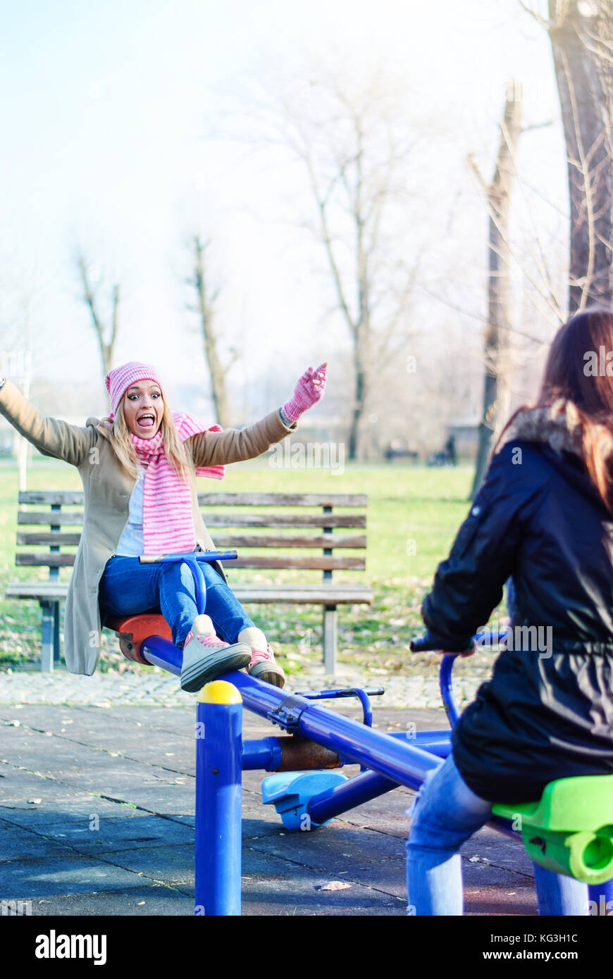 Two teens hang out at the playground - Stock Image