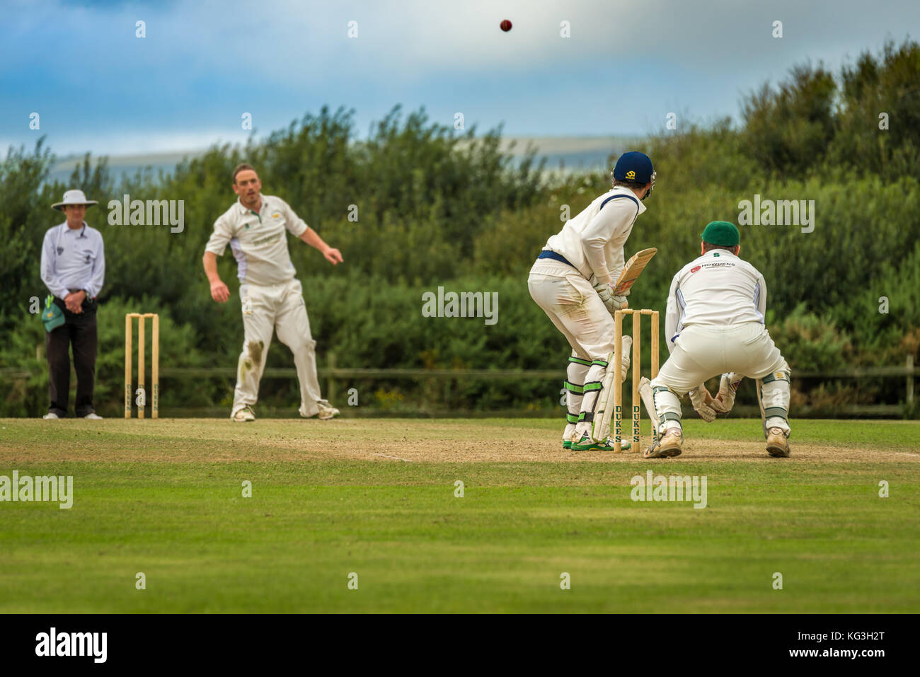 A batsman prepares to play a shot during a Sunday League match between two local Cricket teams. - Stock Image