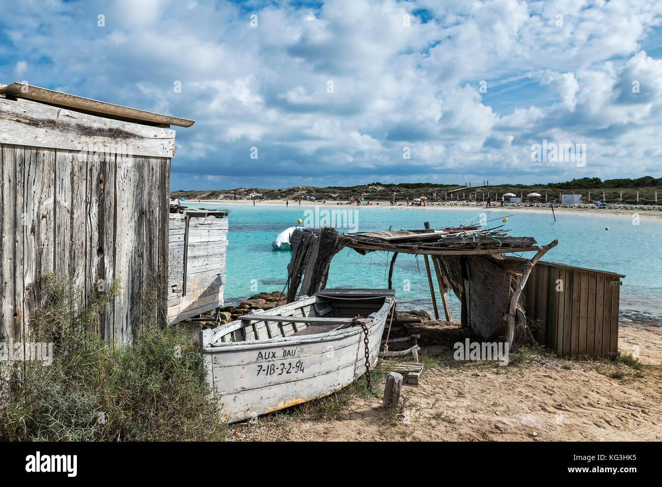Boat and boat shed, Playa des ses Illetes, Formentera, Balearic Islands, Spain. - Stock Image