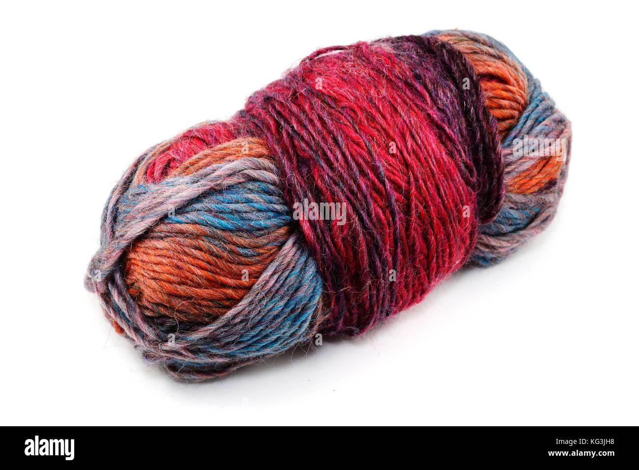 varicoloured ball of wool on white background - Stock Image