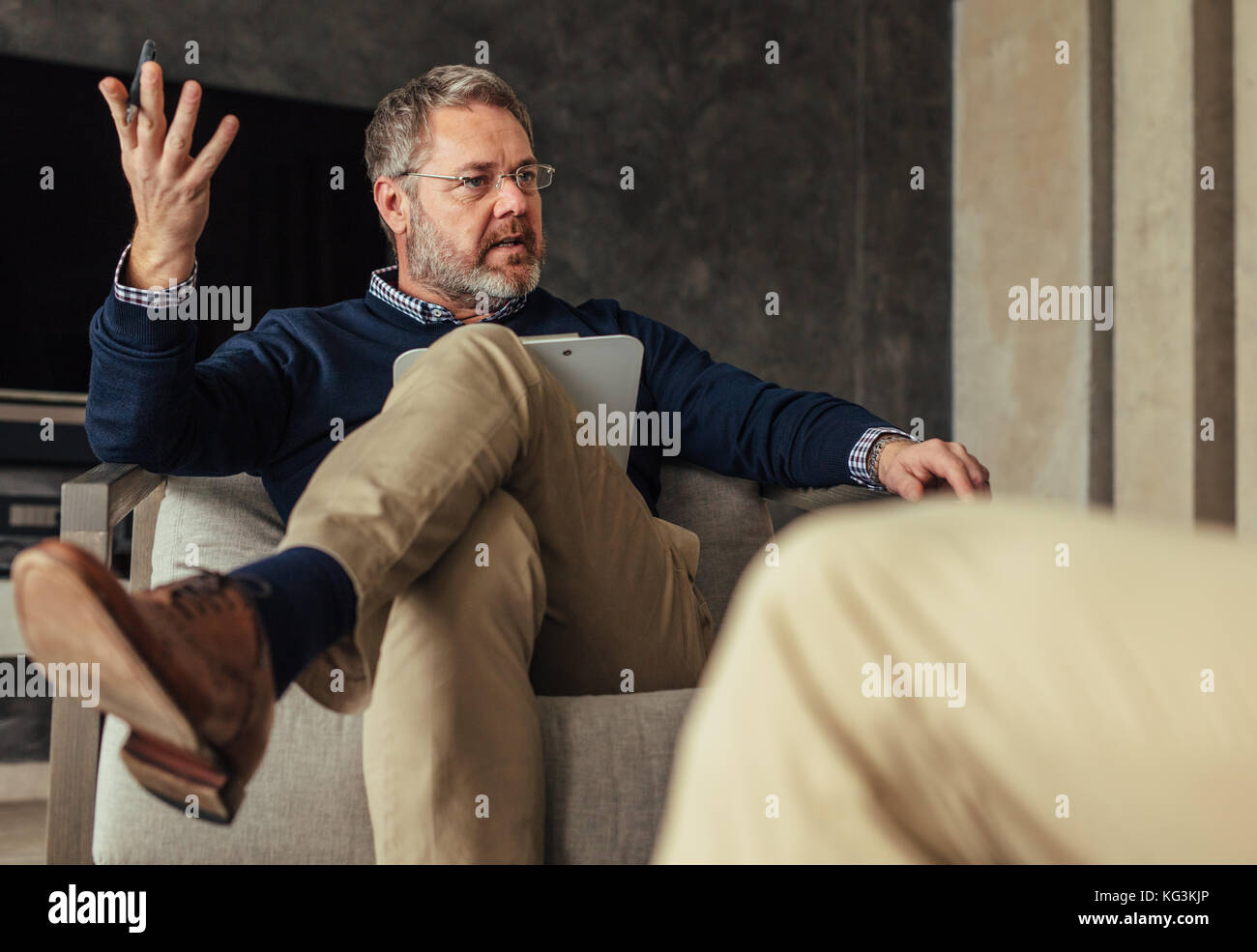 Psychologist talking with patient during the therapy.  Psychotherapist counseling client. Stock Photo
