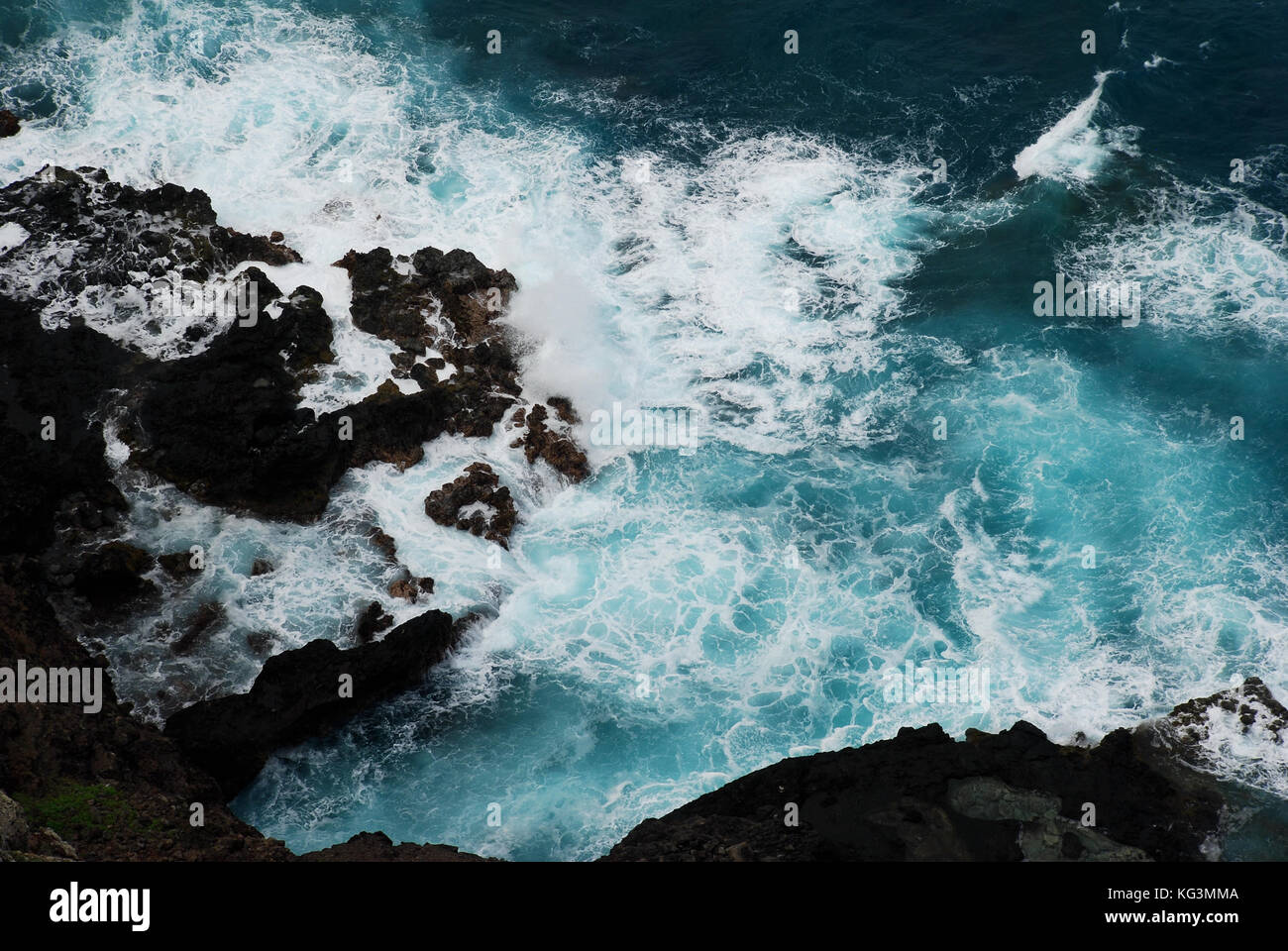 Surf rolls in near Halona Beach Cove - Oahu, Hawaii - Stock Image