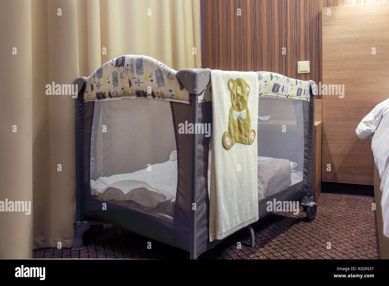 A Gray Portable Baby Bed For Newborns On Wheels Decorated With Stock Photo Alamy