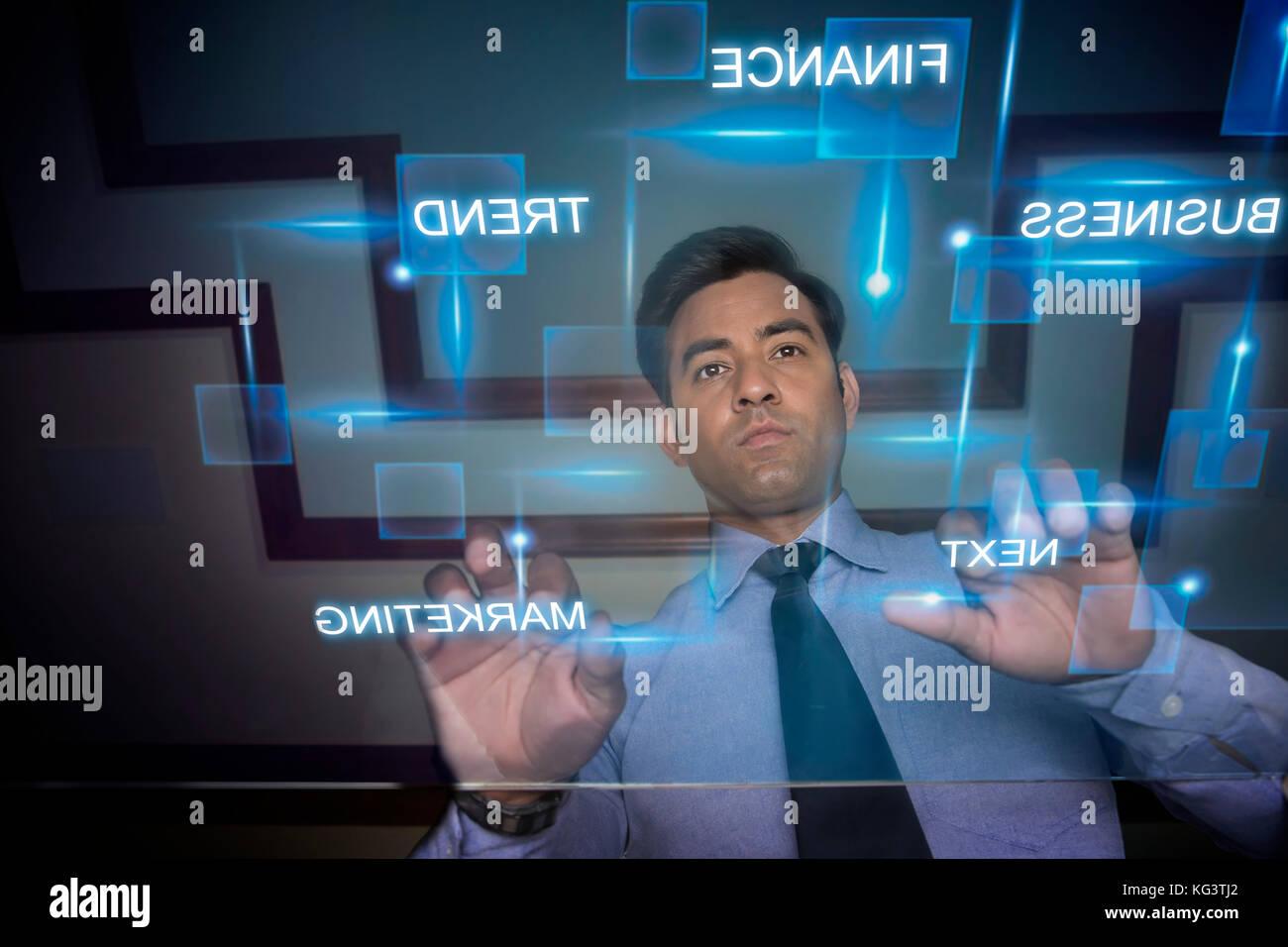 Businessman using futuristic computer keyboard - Stock Image