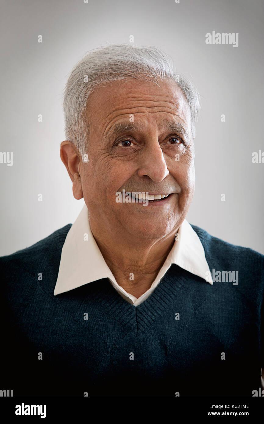 Older happy man looking away - Stock Image
