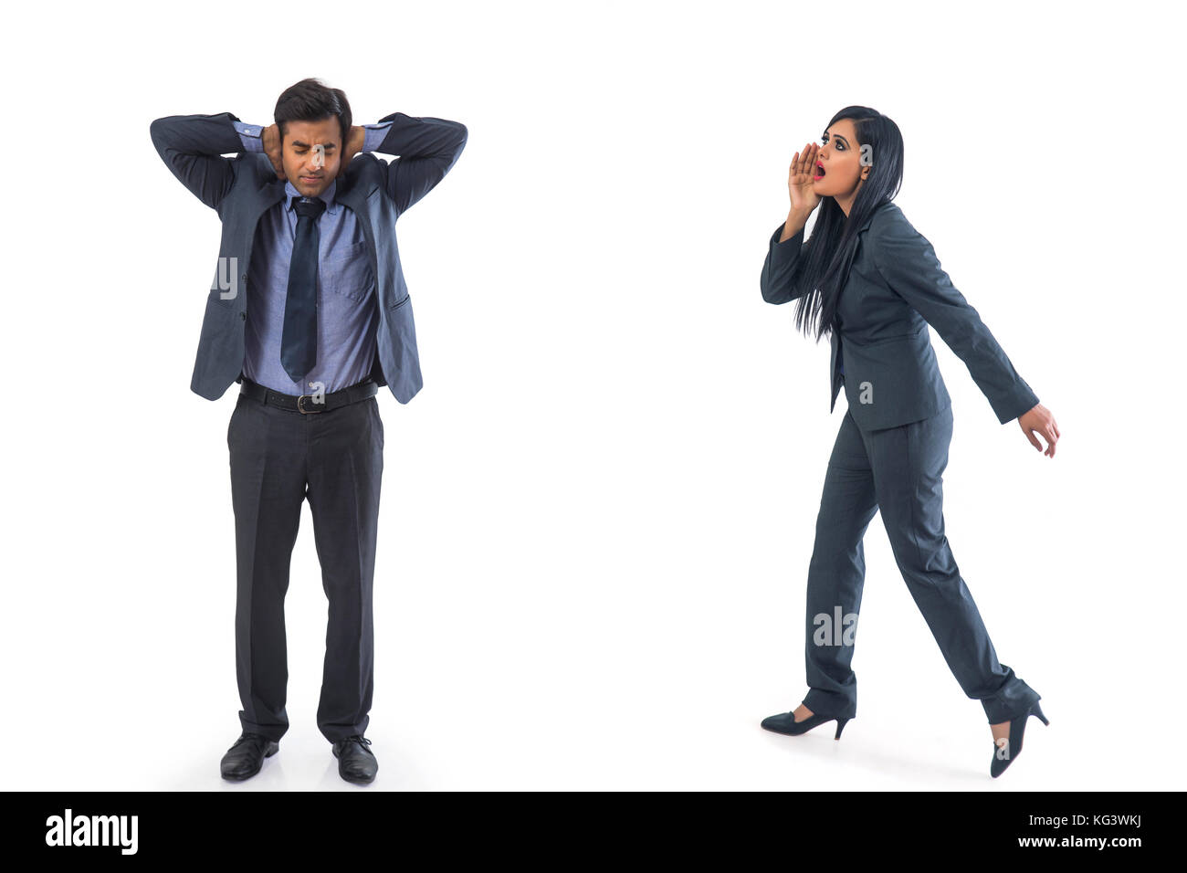 Businesswoman shouting on businessman - Stock Image