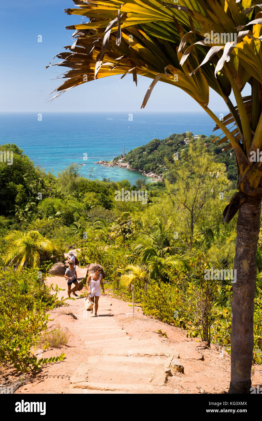 The Seychelles, Praslin, Anse Marie-Louise, Fond Ferdinand Nature Reserve, tourists climbing path to summit - Stock Image