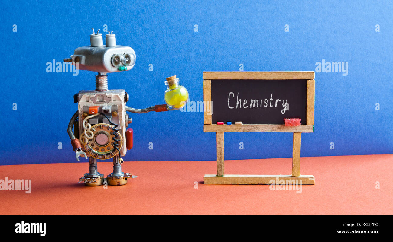 Robot laboratory assistant with a yellow chemical reagent bottle. Bright blue red interior classroom, word Chemistry - Stock Image