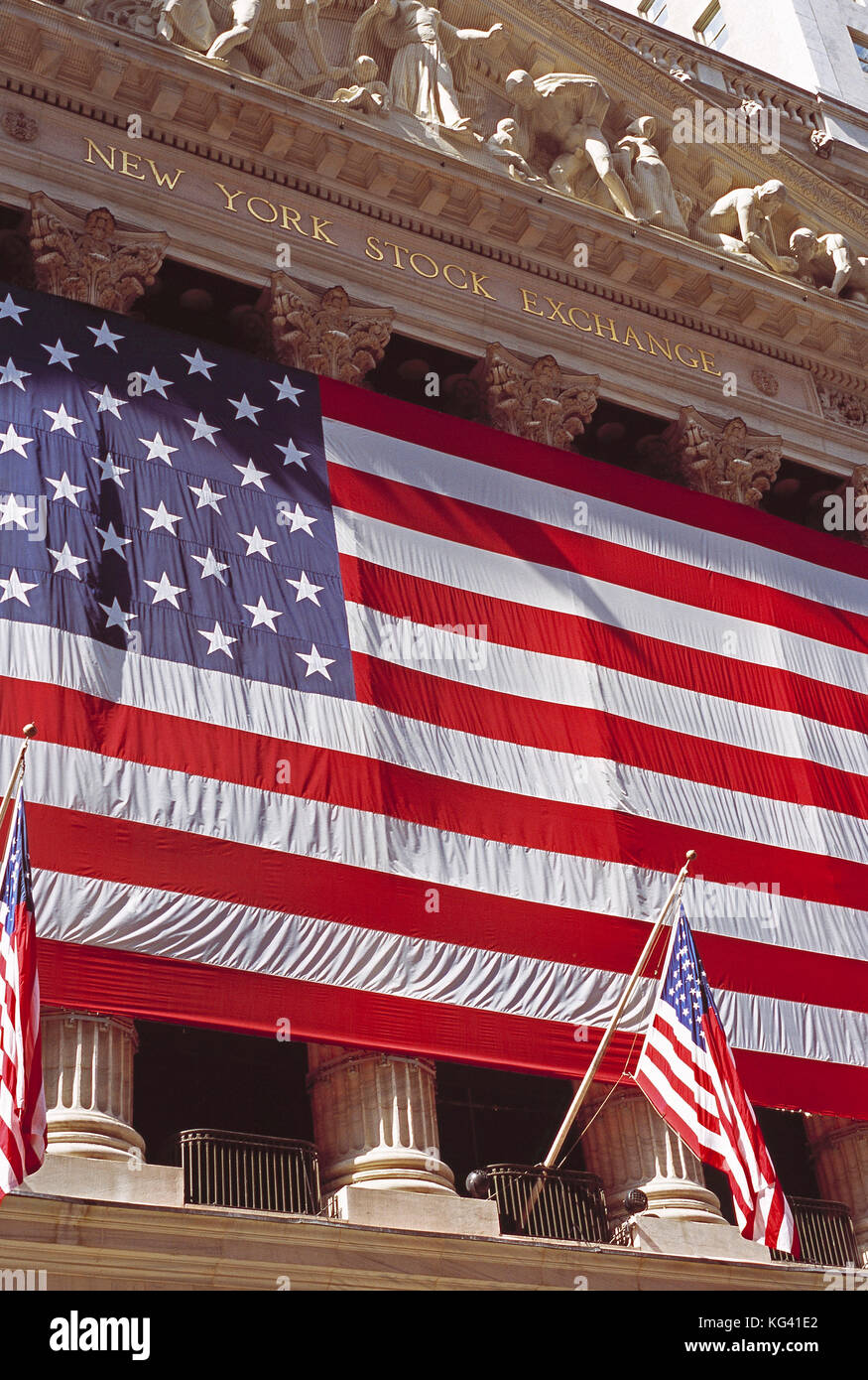 USA. New York. Manhattan. New York Stock Exchange. Close up of flags on front of building. - Stock Image