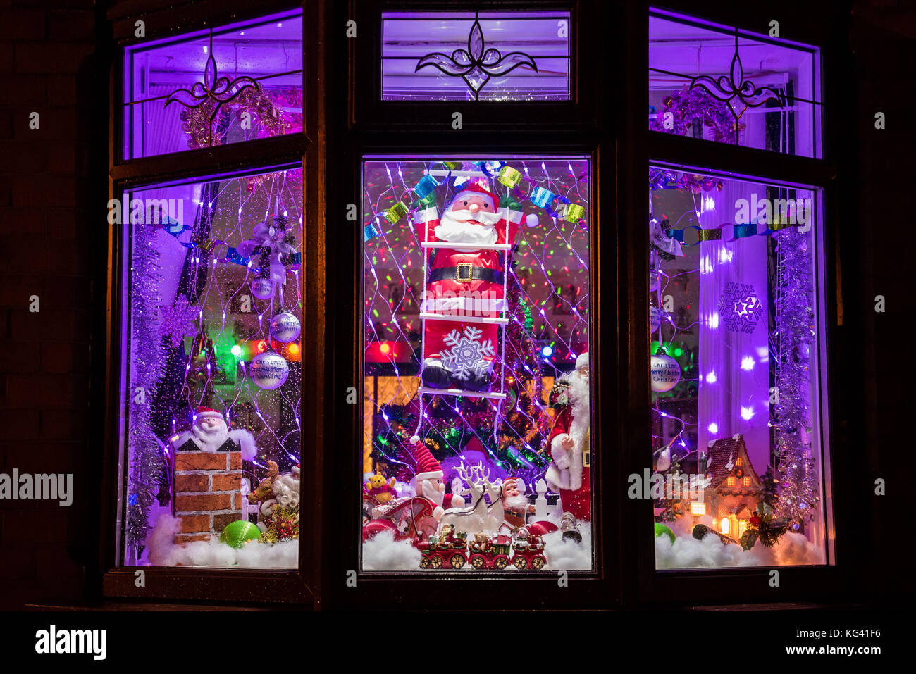 An extravagant display of Christmas decorations in a domestic ...