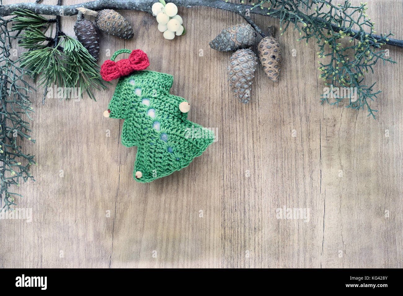 Christmas Ornaments Made In Crochet On Rustic Wooden Background Stock Photo Alamy