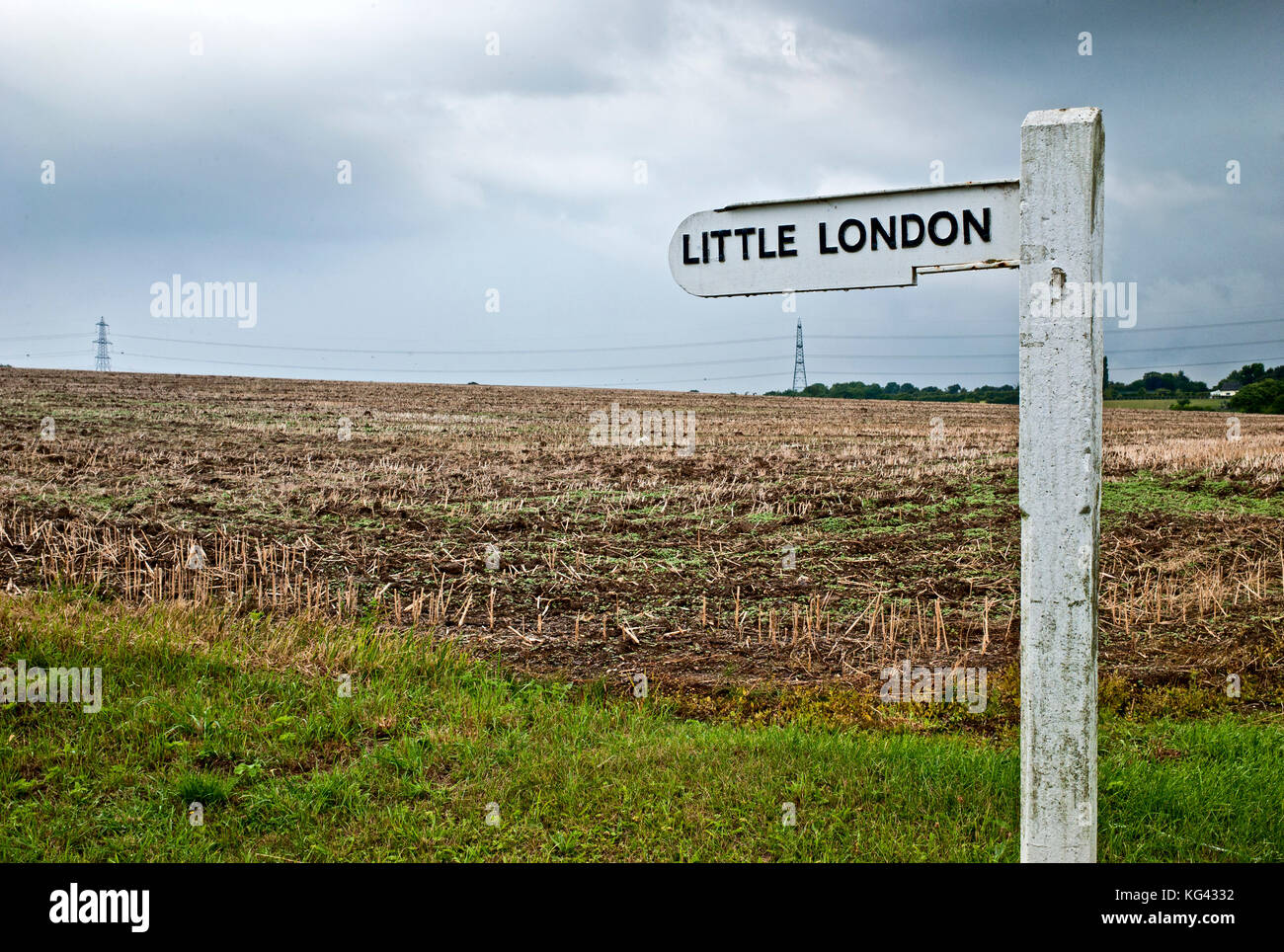 Little London street sign in front of a recently harvested field somewhere in the home counties English countryside - Stock Image