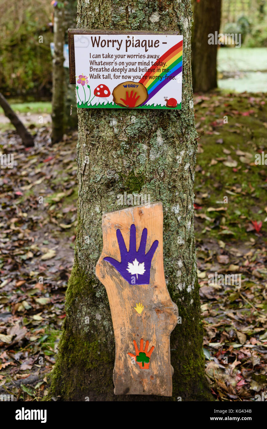 Worry plaque in a garden for children to get rid of their worries. - Stock Image