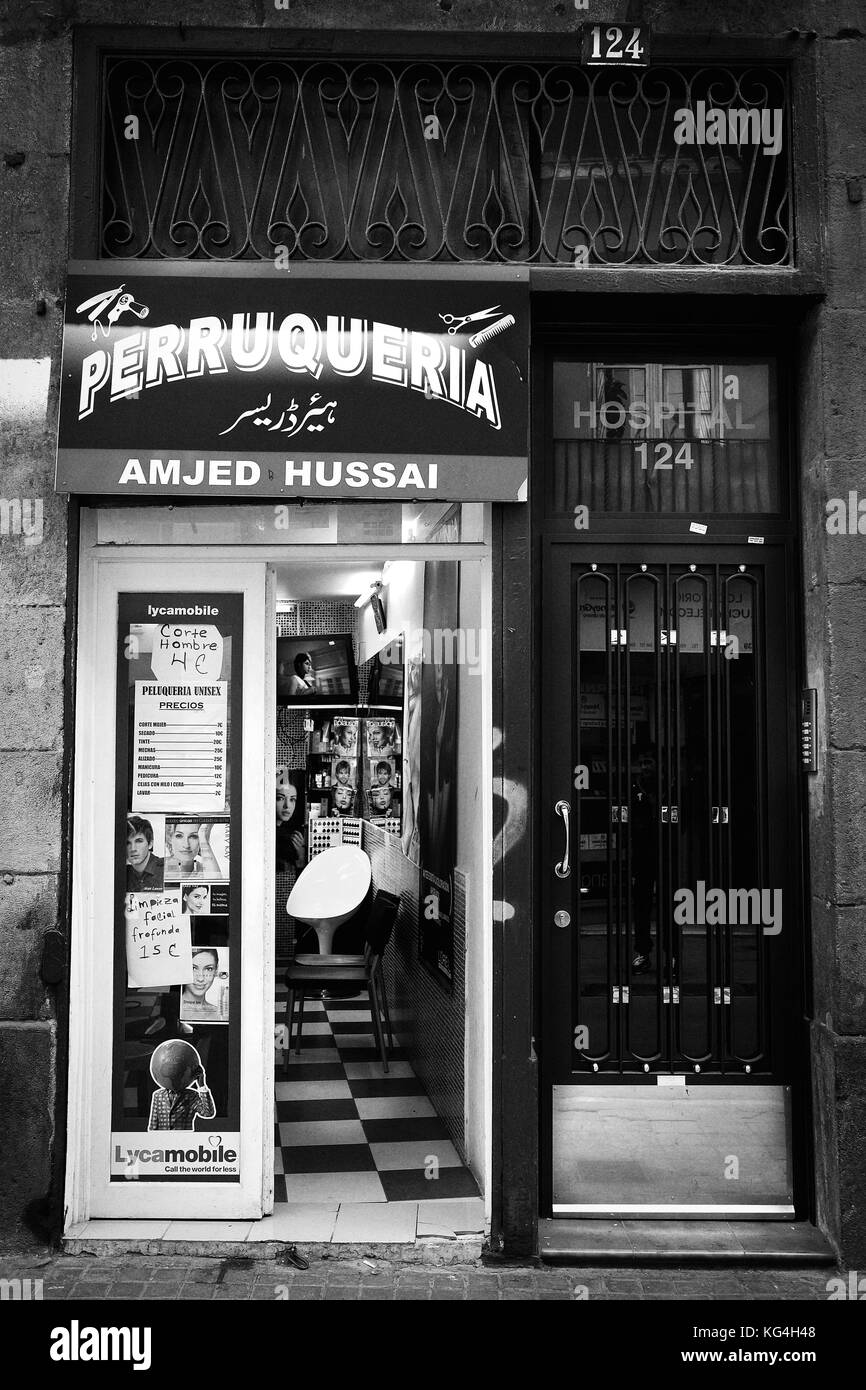 A foreign barbershop now occupies the place of Antonio's Gonzalez watch workshop in the Hospital street of Barcelona, - Stock Image