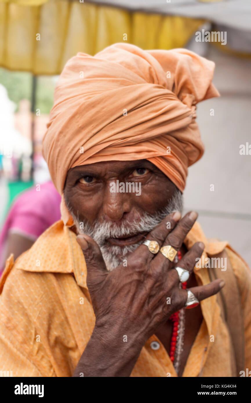 Portrait of a man dressed in orange . Amritsar, India - Stock Image