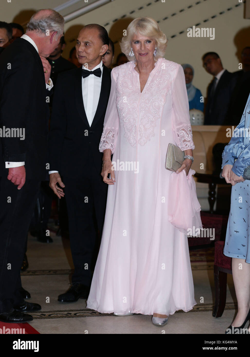 fd5e549ea9b The Prince of Wales and the Duchess of Cornwall speak with shoe designer  Jimmy Choo as they attend a Gala Dinner to celebrate 60 years of UK Malaysia  ...