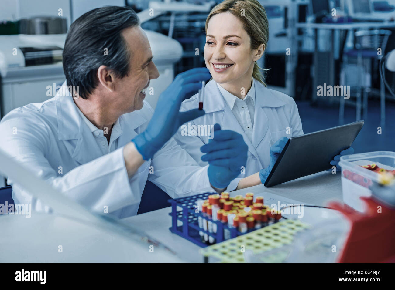 Delighted friendly colleagues interacting with each other - Stock Image