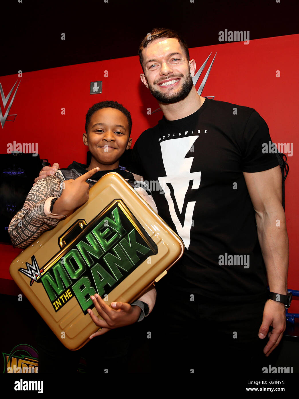 Wwe superstars stock photos wwe superstars stock images alamy wwe superstars finn balor and sasha banks meet children from higham ferrers junior school school to m4hsunfo
