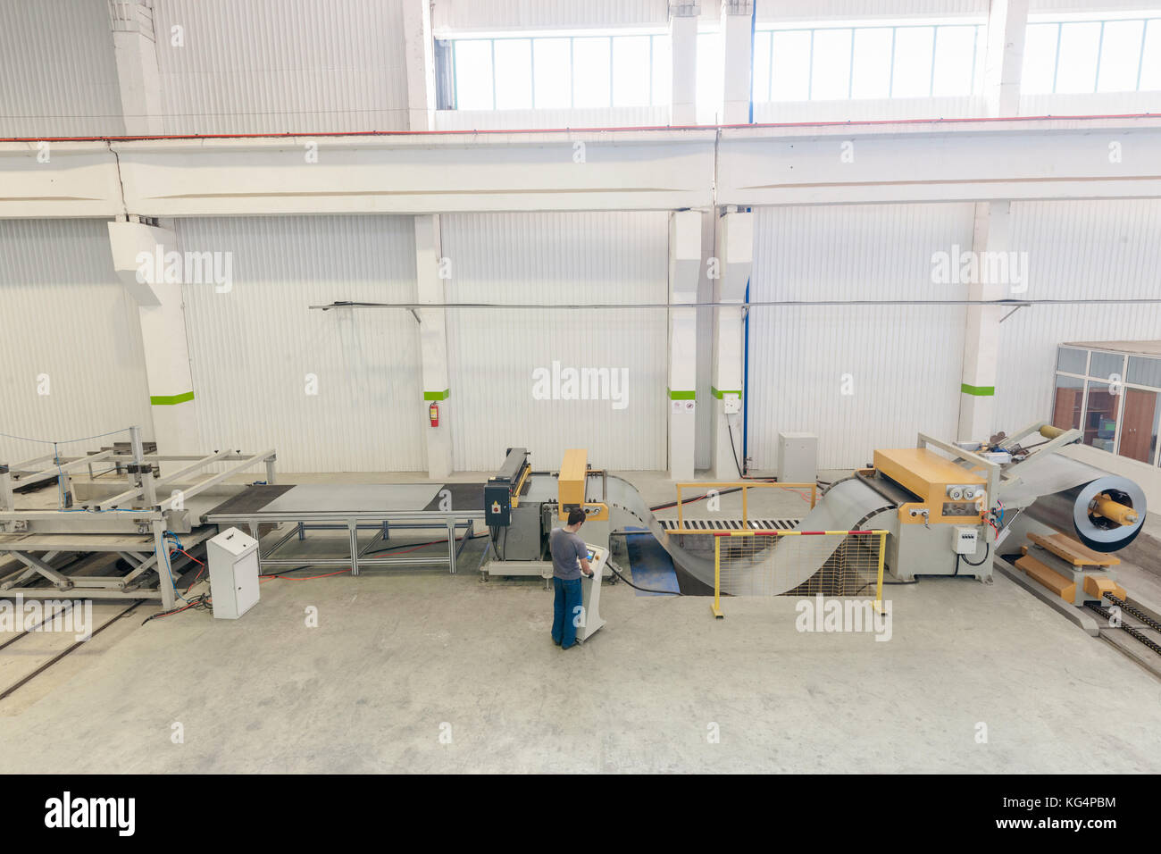 Machine for slitting of steel sheets in rolls. sheet metal working in rolls - Stock Image