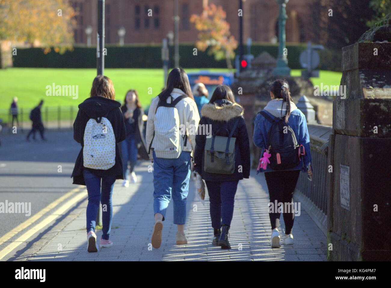 chinese glasgow university students viewed from behind on partick bridge - Stock Image
