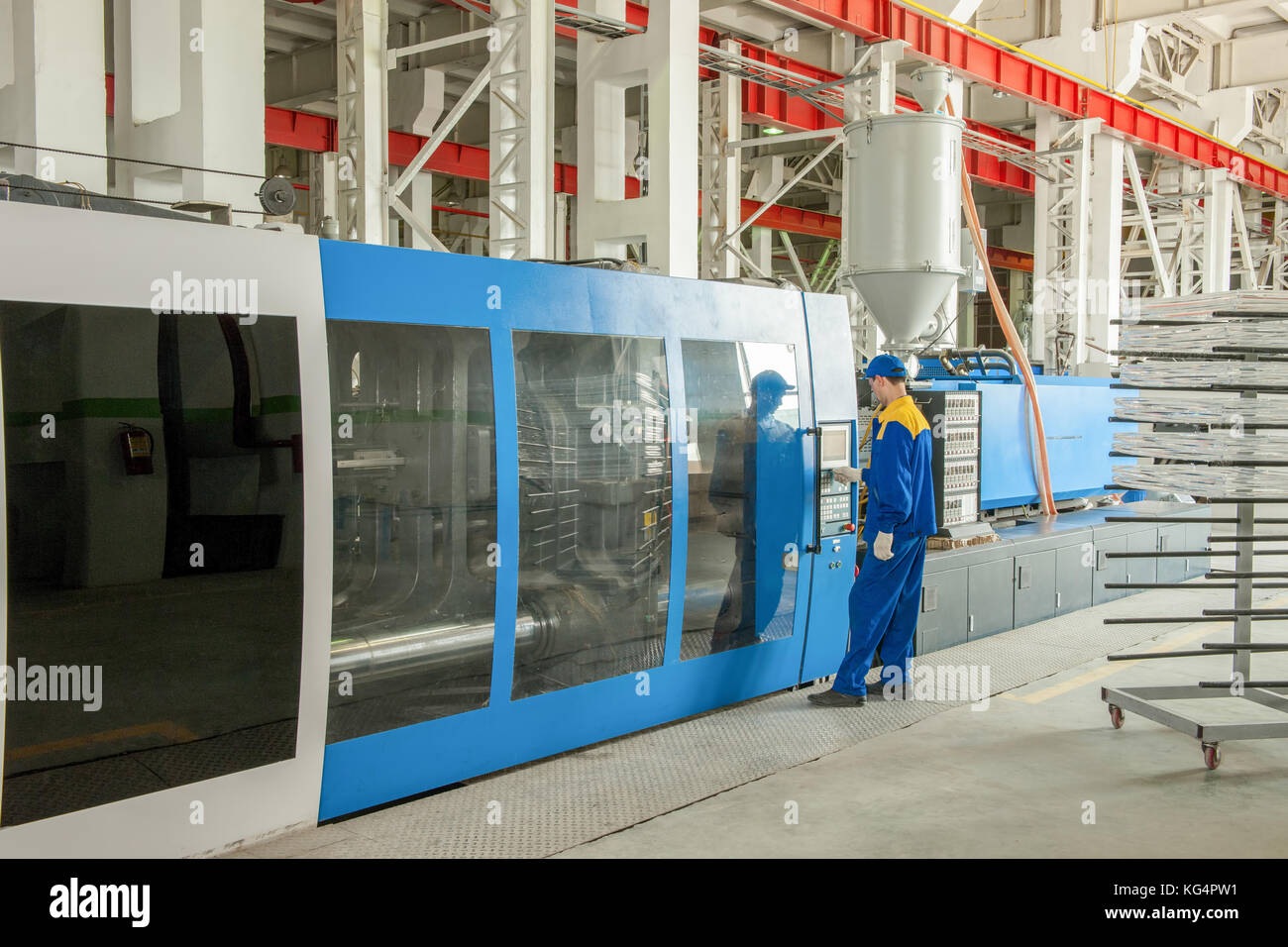 Industrial injection molding press machine for the manufacture of plastic parts using polymers in the management - Stock Image