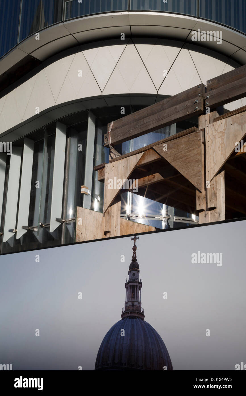 A picture of St. Paul's cathedral dome and some construction background of the One Blackfriars residential tower, Stock Photo