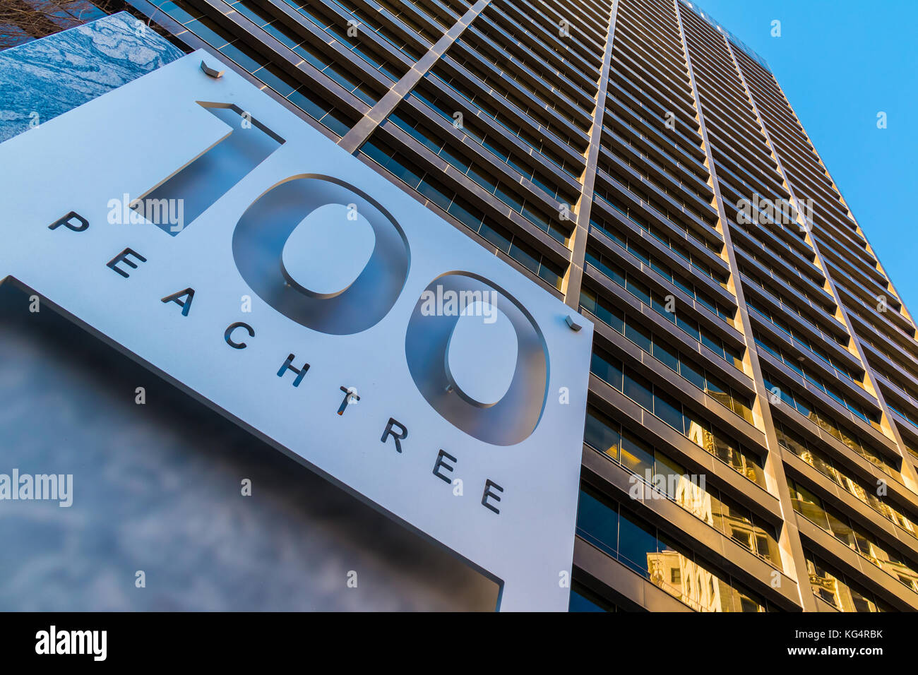 Bottom view of the signboard and office skyscraper at 100 Peachtree St on the background of clear sky, Atlanta, - Stock Image