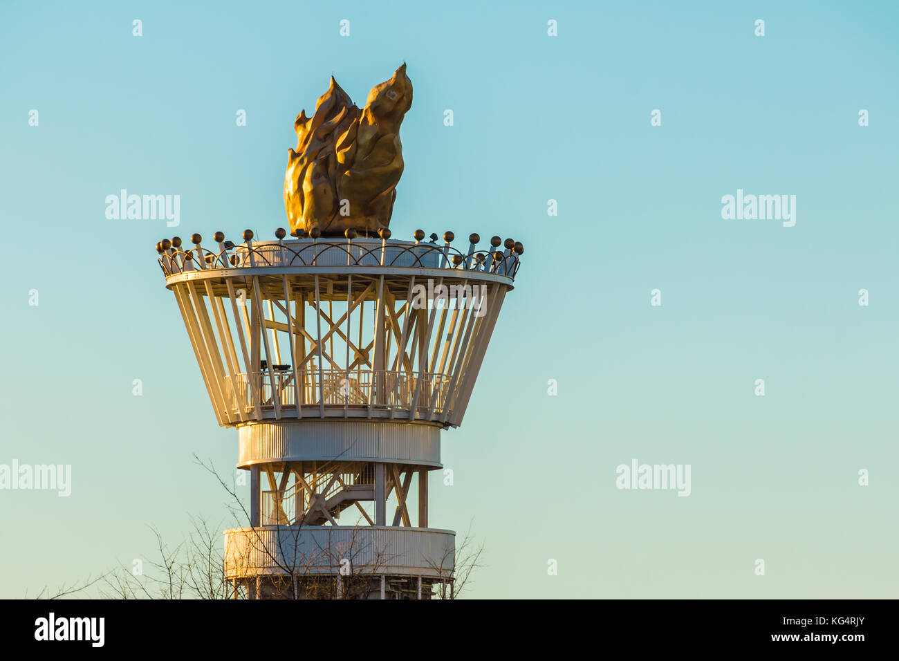 Atlanta Olympic Torch Tower closeup on the background of clear sky at sunset - Stock Image