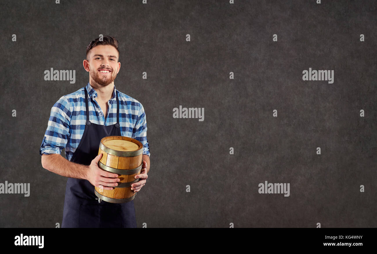 The brewer, the winemaker the munchina with a barrel in his hand - Stock Image