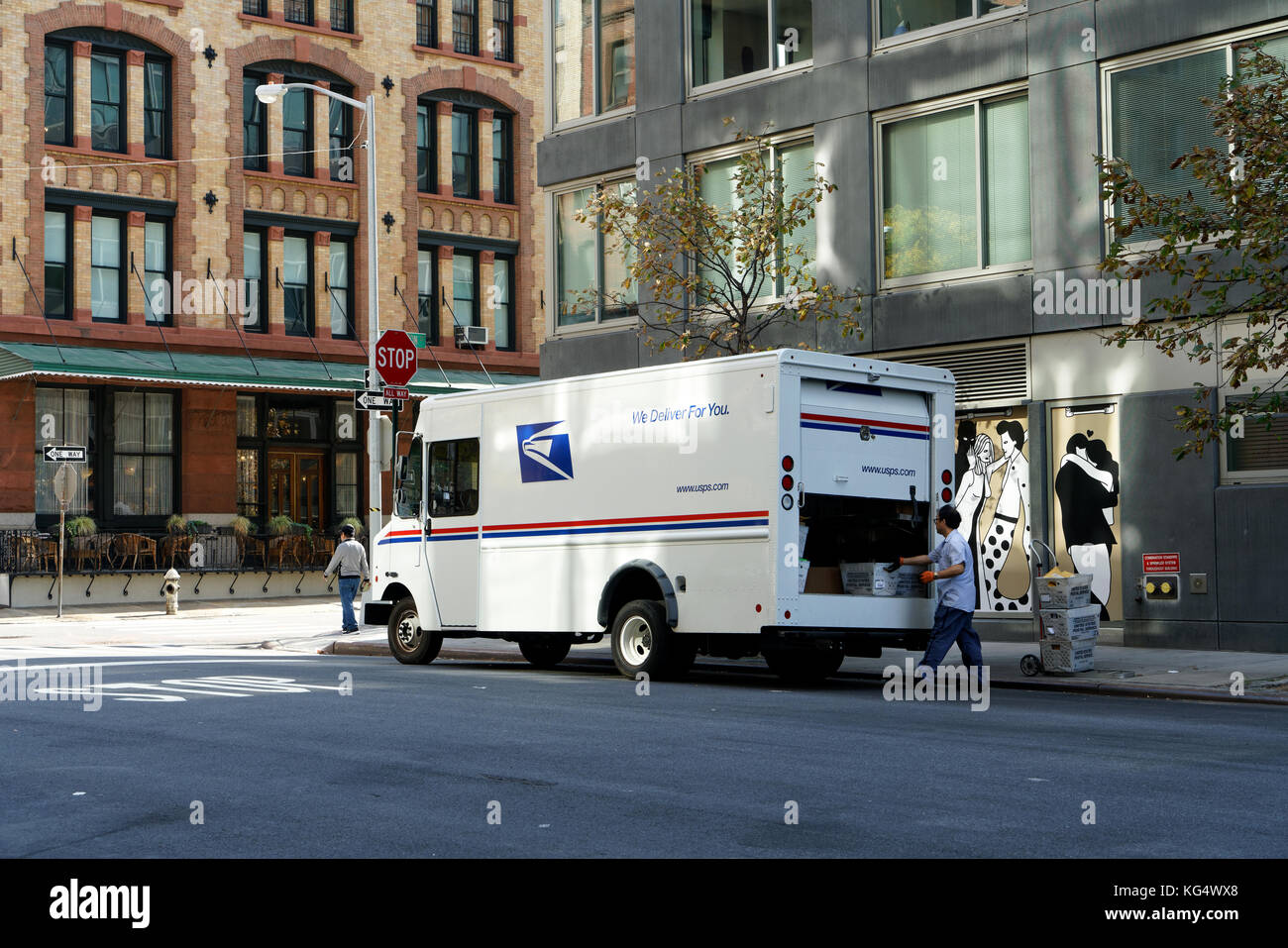 A truck from the US Postal Service making a mail delivery in Tribeca, a neighborhood in Lower Manhattan, New York - Stock Image