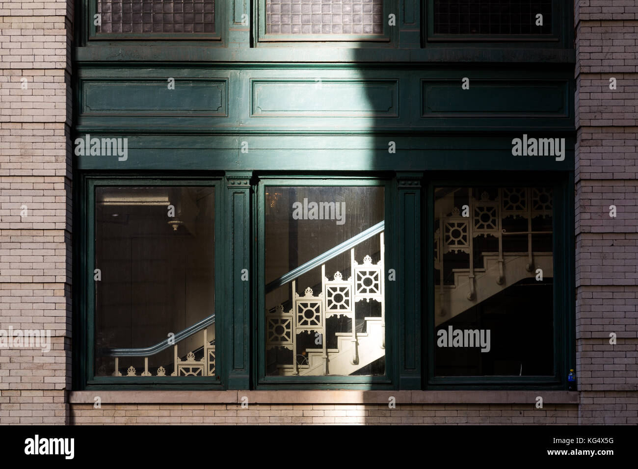 Detail of building window and stairway on 18th street near sixth avenue in New York City. - Stock Image