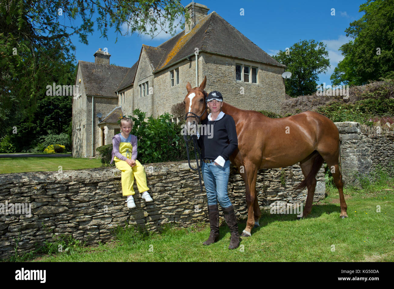 Kelly Luchford and daughter Lola (7) at her house in Gloucestershire. - Stock Image