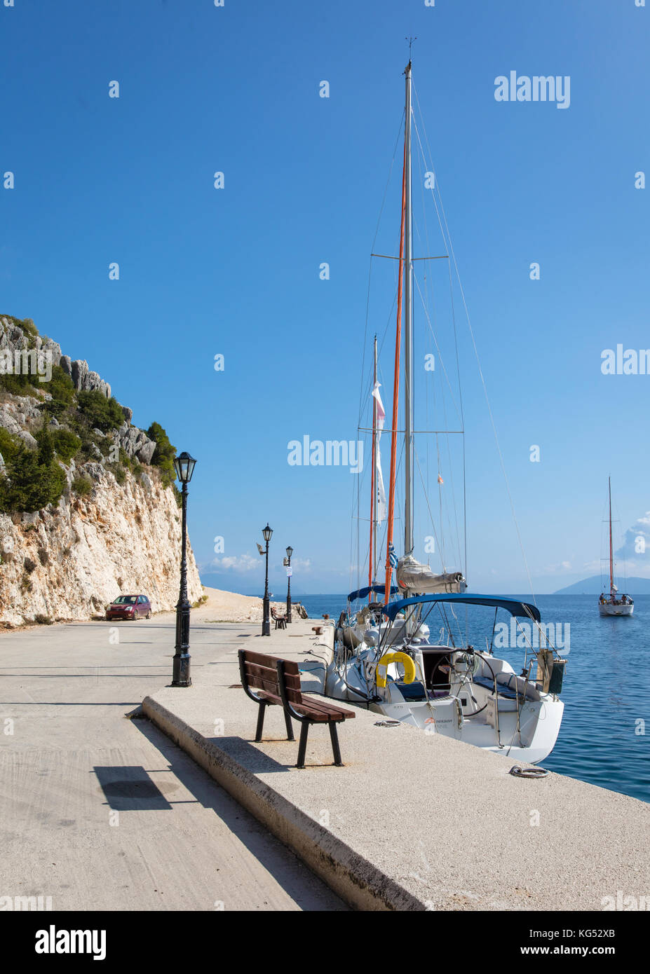 The harbour side in the little fishing village of Frikes on Ithaka in the Ionian Islands Greece - Stock Image