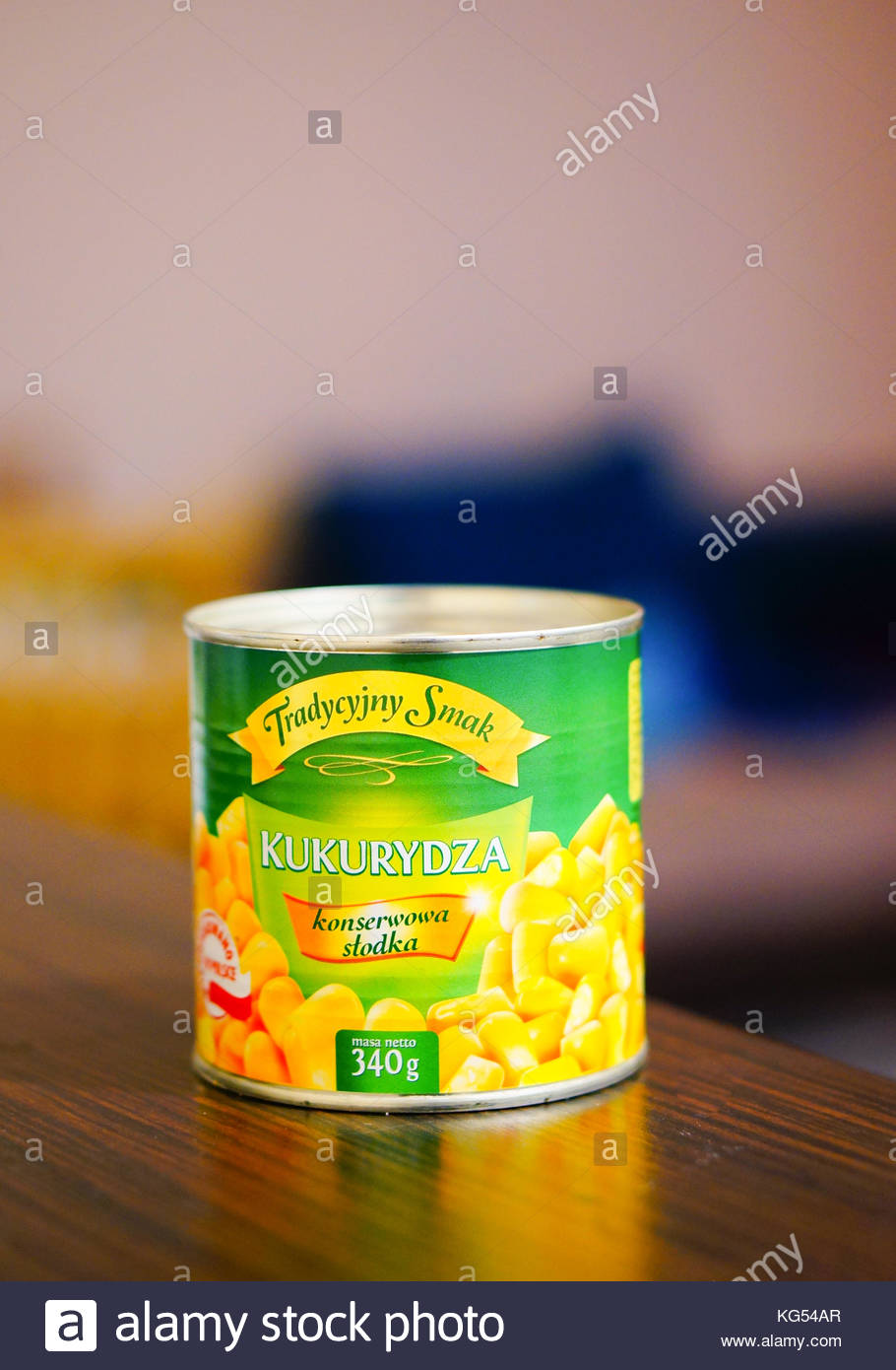 POZNAN, POLAND - FEBRUARY 26, 2016: Polish Tradycyjny Smak corn in a can on table - Stock Image