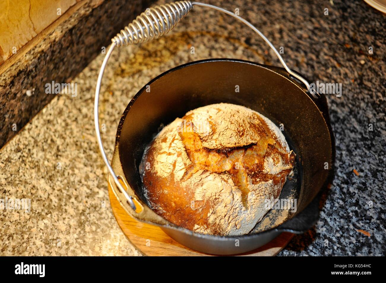 Fresh Crusty Loaf Of Artisanal Homemade Bread Baked In A Lodge Dutch Stock Photo Alamy