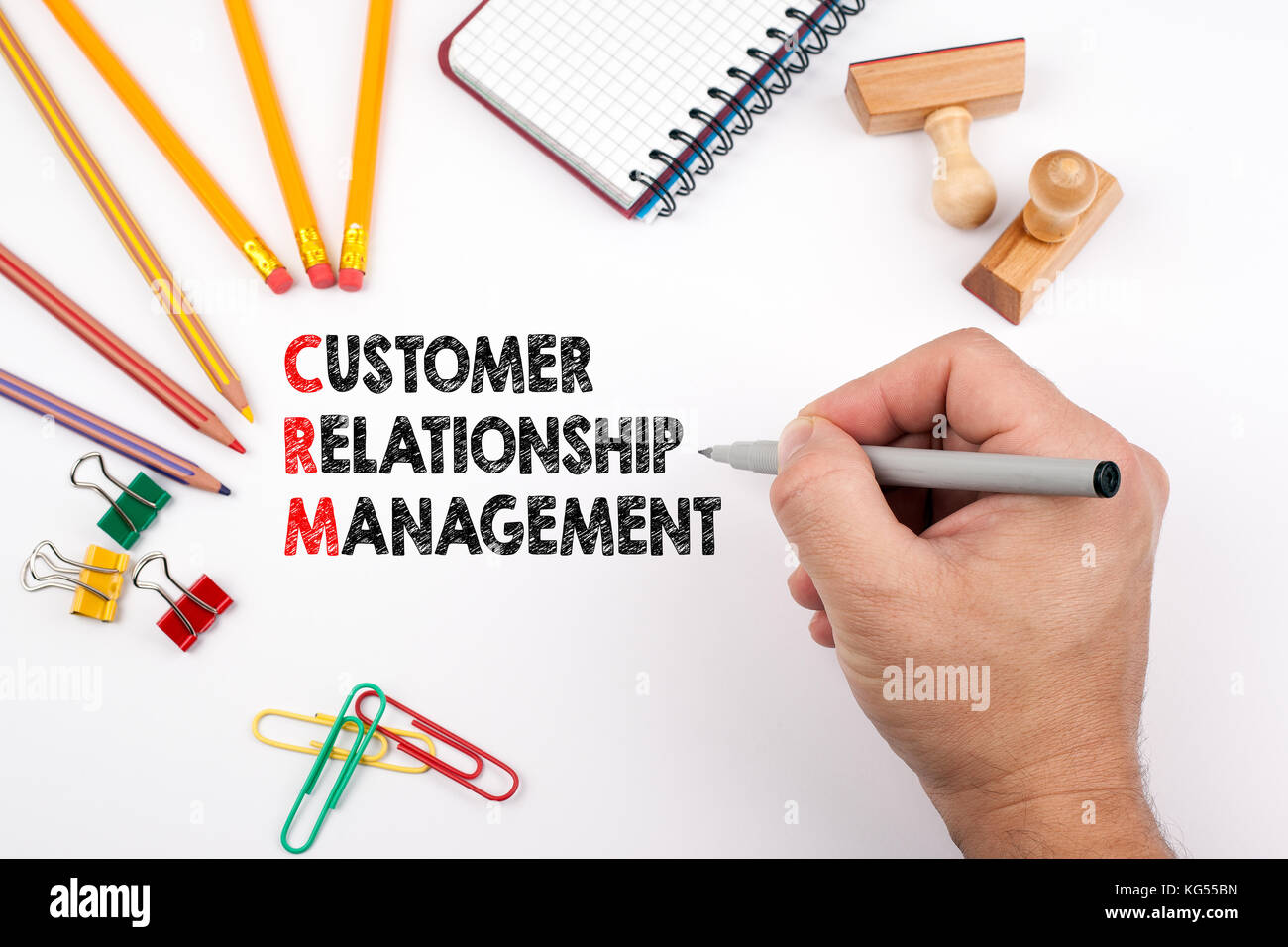 customer relationship management. White office desk on which various items - Stock Image