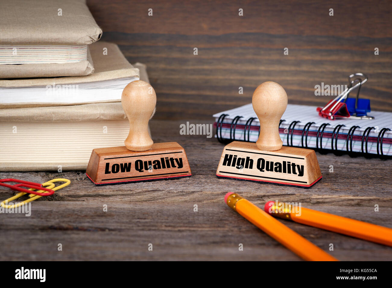 low quality and high quality. Rubber Stamp on desk in the Office. Business and work background - Stock Image