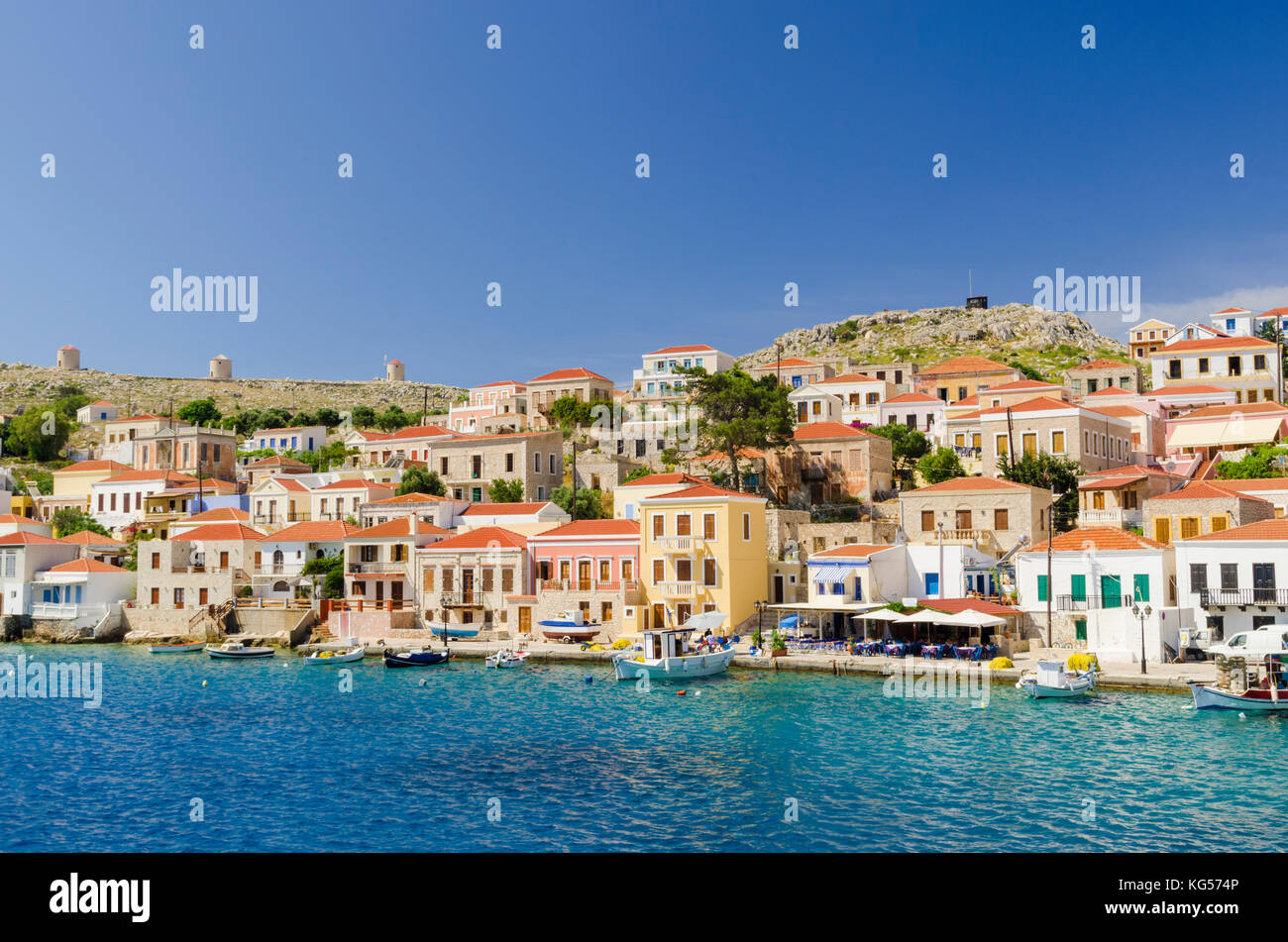 Pretty waterfront views of the port town of Emborios, Halki Island, Dodecanese, Greece - Stock Image