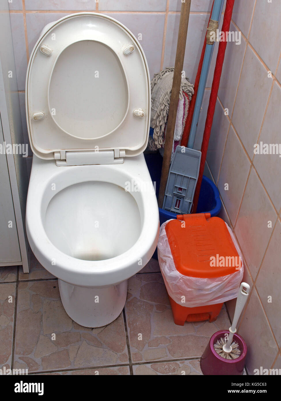 Water closet toilet bowl with open lid - Stock Image
