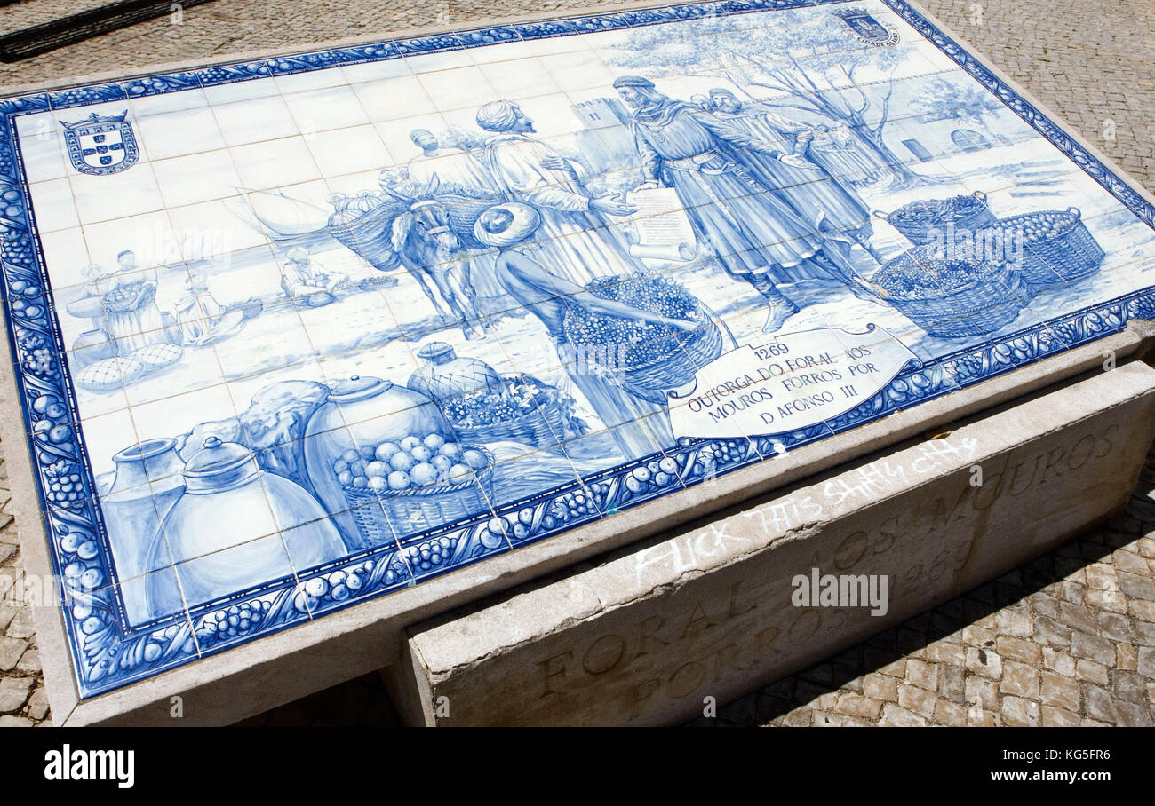 Faro, tile picture (Azulejos) at the entrance to the historical Old Town, showing the moment of the handover of - Stock Image