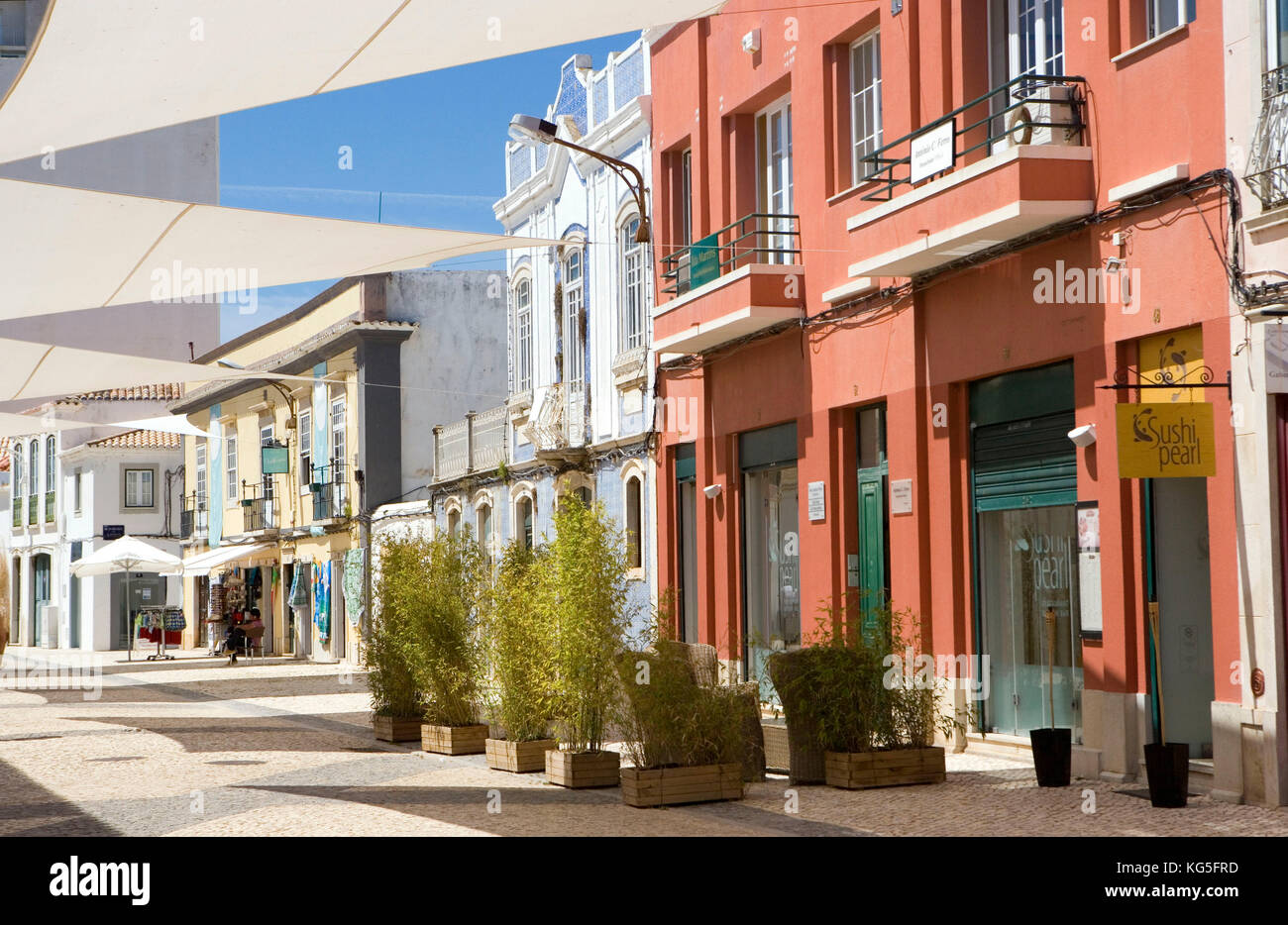 Faro, street in the purchasing fourth with shops, cafés, restaurants - Stock Image
